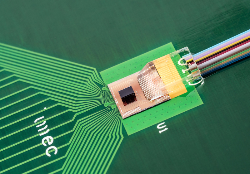 TSV-assisted FinFET CMOS/Si photonics transceiver prototype.