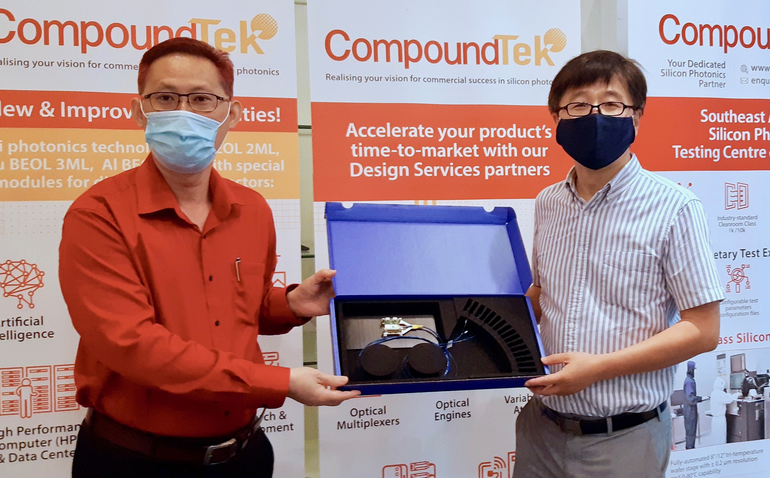K.S. Ang, COO of CompoundTek, and Professor Wang, of NTU.