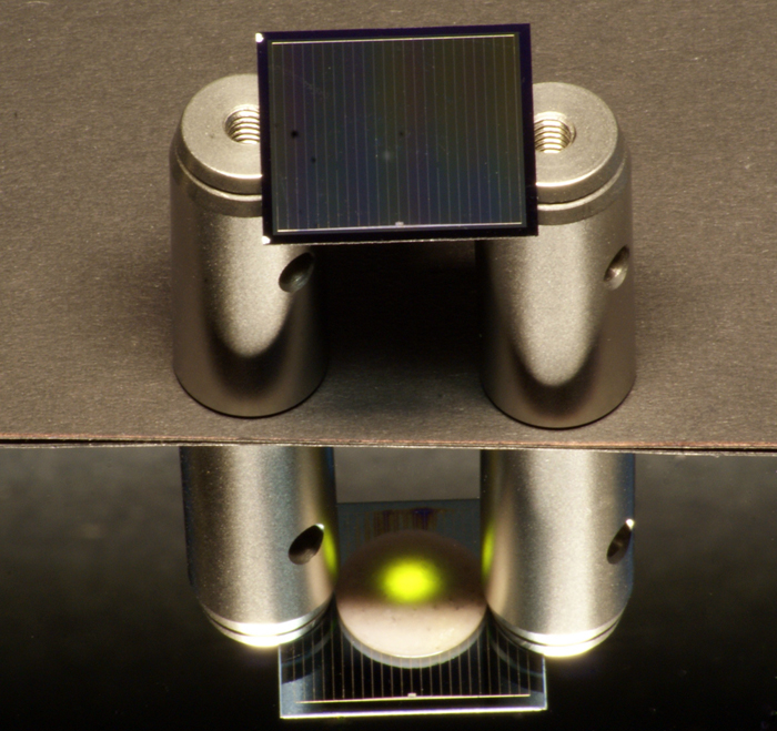 A two-sided silicon solar cell illuminated by an infrared laser.