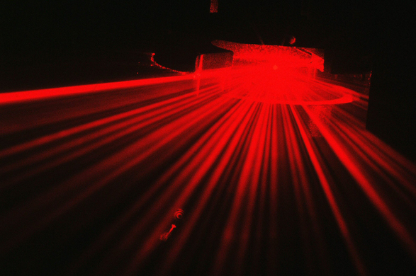 Red alert: Light scattering from a thin fibre particle illuminated by a laser beam.