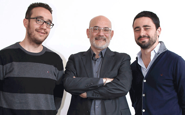 Prof Spagnolo, center, with two of his team.
