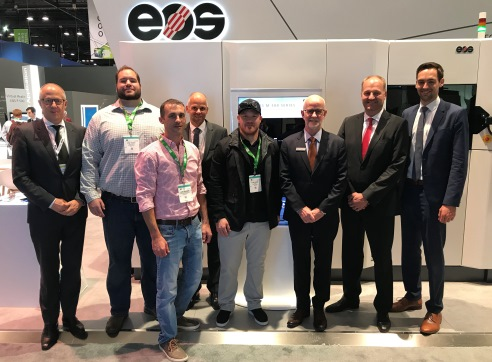 It's a deal: Visser Precision and EOS teams meet in Chicago.