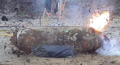 Successful field trial: controlled explosion after bomb defused by laser.
