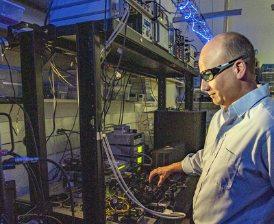 One, two... NIST physicist Thomas Gerrits adjusts the laser beam hitting a detector.