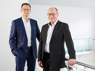 President & CEO Dr. Stefan Traeger and CFO Hans-Dieter Schumacher.