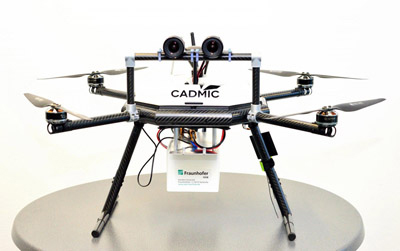 Drone with stereo camera; the white box holds the embedded system.