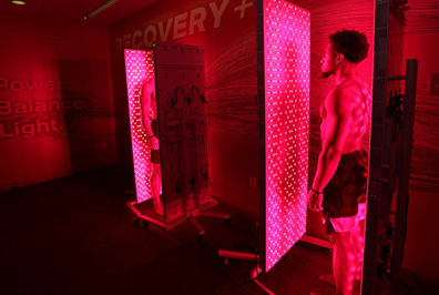 Red and red: 49ers Fred Warner and K'Waun Williams using light therapy room.
