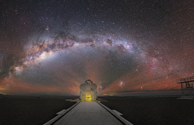 The Milky Way stretched out behind one of the Auxiliary Telescopes of ESO's VLT.