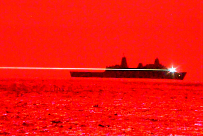 Red for danger: USS Portland fires its laser weapon at the UAV.