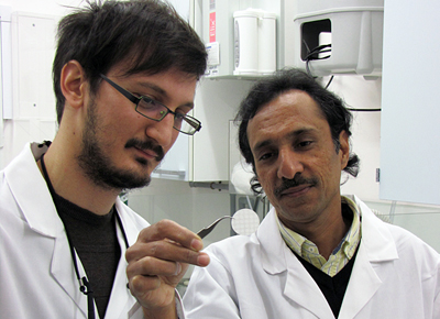 Fine print:Dr Collin Sones (left) and PhD student Ioannis Katis inspect paper sensor.