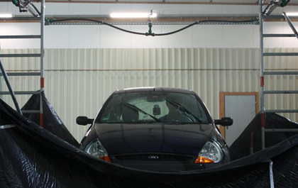 Stormy weather? A car tested under a rain simulator.