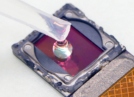 A test sample is placed directly onto the surface of the (cellphone's) image sensor.