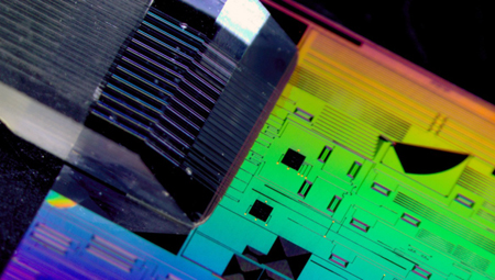 Collaboration: packaged passive silicon photonics chip.