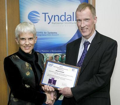 Kelin Kuhn, Intel, presents Tyndall's Brian Corbett with the award.