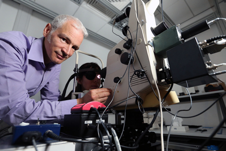 Dr Tom Margrain with his retinal densitometer at Cardiff University.