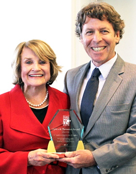 Louise Slaughter receives award from RRPC's Tom Battley.