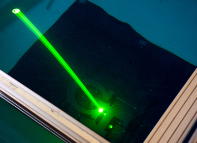 The lightweight lidar prototype uses a green laser to penetrate water at depth.