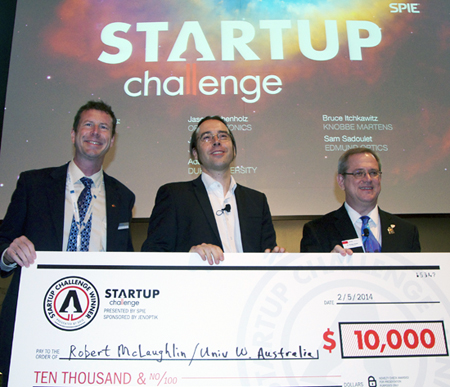 Robert McLaughlin (center) is presented with his Startup Challenge prize.