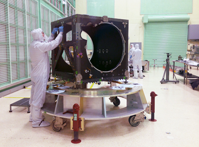 An engineer checks ICESat-2's box structure.