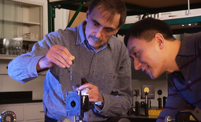 Professor Chunlei Guo (r) with Anatoliy Vorobyev, of Rochester's Institute of Optics.