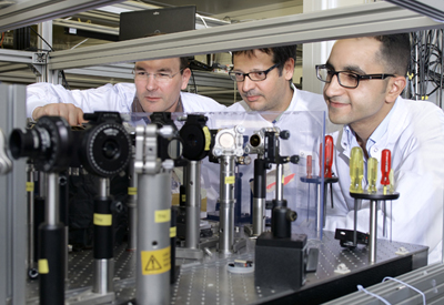 Christoph Hauri, Carlo Vicario and Mostafa Shalaby in the laser laboratory at PSI.