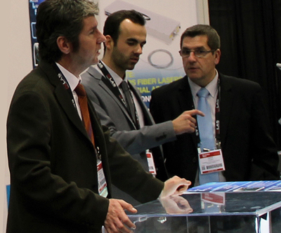 Route des Lasers members discuss opportunities at an exhibition.