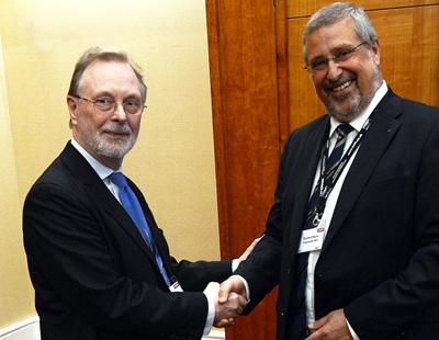 AILU President Neil Main (left) congratulates Prof Eckhard Beyer.