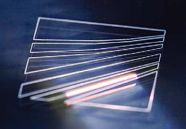 Creating microstructures on glass using an ultrafast laser.