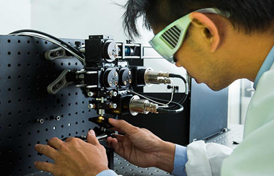 Dr Steve Lee works on a laser microscope system.