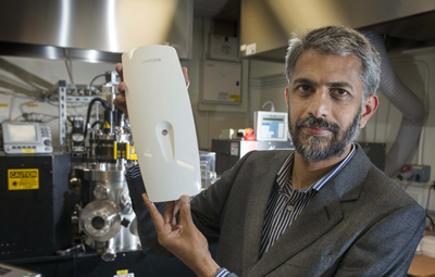 Painless: Professor Gin Jose with the prototype diabetes tester.