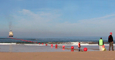6000km to go: undersea cable-laying starts at the beach.