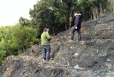 The coal truth: Two of the researchers fitting sensors in a spoil heap in Portugal.