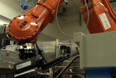 The weld scanning system is mounted on a robot arm.