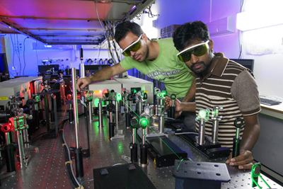 Researchers Margiolakis and Mariserla generating terahertz radiation.