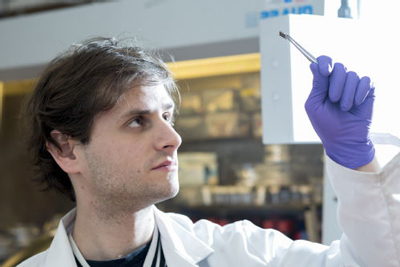 Warwick PhD student Kenny Marshall with a lead free solar cell.