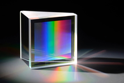 Directly bonded fused silica GRISM (grating + prism).