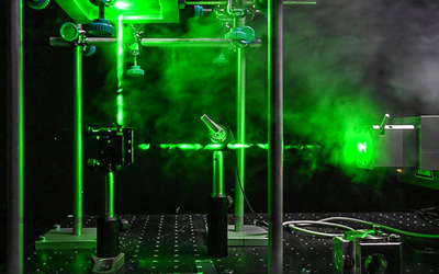 Set up: Coupling agent triazolinediones (TADs) is exposed to green laser light.