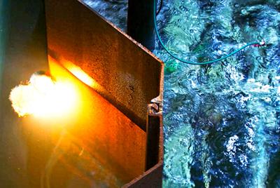Laser cutting of sheet piling under water.