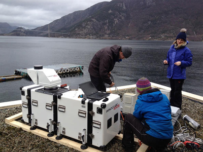 Researchers prepare a long-range lidar laser instrument WindCube100S.