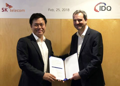 It's a deal: SK Telecom's Park Jung-Ho and Grégoire Ribordy, CEO of ID Quantique.