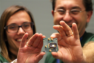 Ericsson's Antonio D'Errico and Teresa Pepe show a graphene-based photonic switch.