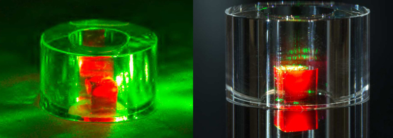 Maser is activated by green laser light; the red light is fluorescence from the NV centers; (right) the diamond is held inside a sapphire ring before the laser is used.