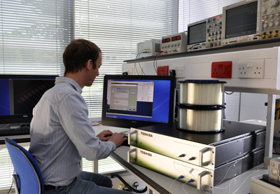 A Toshiba Research Europe scientist working on a QKD system.