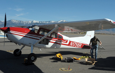 Right angle: setting up the LiDAR in the plane for a flight over Yellowstone Lake.
