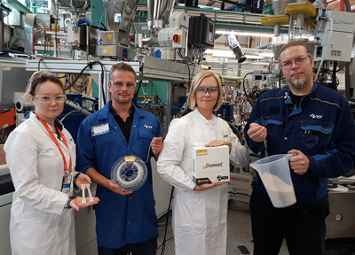 VTT Polymer Pilot unit employees with the nanodiamond material.